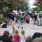 Hula-hoop contortionist Skye Broberg's street act proved popular with pedestrians on Saturday at...