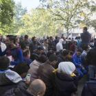 Hundreds of migrants wait  at Berlin's central registration  centre for refugees and asylum...