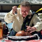 Iain Seatter passionately leads the haggis ceremony at St Andrew's Day celebrations in Dunedin on...