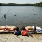 In this  May, 26, 2010 file photo, Katie Pekkuala, left, and Jake Hebert, right lie on the edge...