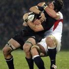In this Otago Daily Times file photo All Black Richie McCaw is tackled by an English rugby player.