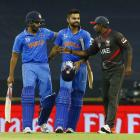 India's batsmen Rohit Sharma (L) and Virat Kohli are congratulated by United Arab Emirates' Andri...