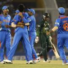 India's players celebrate the dismissal of Pakistan's Abdul Razzaq, second from right, during the...