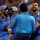 India's Virat Kohli (R) celebrates with teammates after they beat South Africa at the Melbourne...