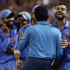 India's Virat Kohli (right) celebrates with teammates after they won their Cricket World Cup...