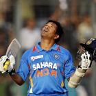 Indian batsman Sachin Tendulkar celebrates scoring his 100th international century during the...