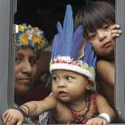 Indigenous people arrive at a meeting by bus during the Rio+20 United Nations Conference on...