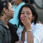Inmates' relatives stand outside a prison after a fire which killed more than 350 inmates broke...