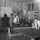 Inside the mess building at Piha in 1943, showing WAAF radar operators, relaxing with air force...