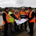 Inspecting the plans for the new Materials Recovery Facility in Green Island are (from left)...