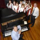 International orchestral conductor Roy Goodman (seated) with members of the Southern Youth Choir...