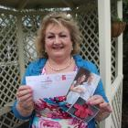Invercargill crafter Ann-Marie Searle holds up the card sent on behalf of the Duke and Duchess of...