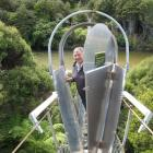 Invercargill MP Eric Roy inspects a possum-proof gate fitted to a bridge over the Waitutu River....