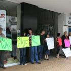 Invercargill National MP Eric Roy (left) talks to a group protesting yesterday against a city...