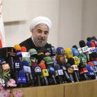 Iranian President-elect Hassan Rowhani speaks with the media during a news conference in Teheran...