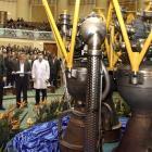 Iranian President Mahmoud Ahmadinejad, left, listens to his Defence Minister Gen. Ahmad Vahidi,...