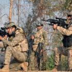 Iraqi security forces take up position during an intensive security deployment against Islamic...