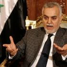 Iraqi vice-president Tareq al-Hashemi gestures as he speaks during an interview with Reuters in...