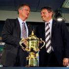 IRB Chairman Bernard Lapasset (L) and Rugby New Zealand 2011 Limited CEO Martin Snedden pose...