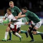 Ireland's Donnacha Ryan grabs onto Russia captain Alexander Yanyushkin during their Rugby World...