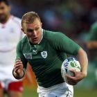 Ireland's Keith Earls on his way to scoring a try against Russia. REUTERS/Bogdan Cristel