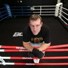 Irish boxer Martin Rogan relaxes in the ring. He is preparing for the Super 8 tournament on...
