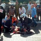 Israeli medics treat a wounded soldier at the scene of a stabbing attack in Tel Aviv. REUTERS...