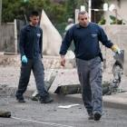 Israeli sappers remove remnants of an exploded rocket fired by Palestinian militants from Gaza at...