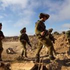 Israeli soldiers walk during training close to the ceasefire line between Israel and Syria on the...
