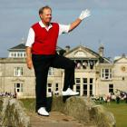 Jack Nicklaus waves to the crowd from Swilcan Bridge on the 18th fairway at St Andrews. Photo...