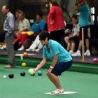 Jacqui O'Brien, from New South Wales, lines up a bowl during a cruise ship challenge match at the...