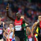 James Kiplagat Magut (C) crosses the line to win gold ahead of silver medallist Ronald Kwemoi and...