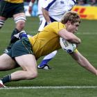 James O'Connor scores a try during their Rugby World Cup Pool C match against Italy. REUTERS...