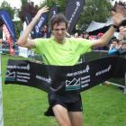 James Parsons, of Palmerston North, crosses the finish line to win the men's section of the...