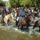Jane Whitmore's Moonlight Wanderers Goldfields Cavalcade trail crosses the Taieri River, near...