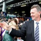 Japan coach, All Black great John Kirwan, greets well-wishers as his team arrives at Auckland...