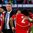 Japan coach John Kirwan watches as team captain Takashi Kikutani (R) and Shota Horie hug after...
