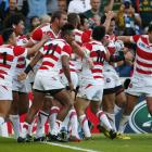 japan_players_celebrate_after_a_scoring_a_try_to_b_55fda0e433.jpg