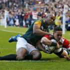 Japan's Karne Hesketh dives over to score the match-winning try against South Africa. Photo Reuters