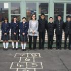 Japanese teacher Debra Hayama (centre) with some of her pupils visiting East Otago High School....