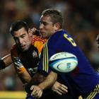 Jarrad Hoeata of the Highlanders tackles Nick Crosswell of the Chiefs during the round six Super...