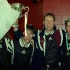 Jason Tee (left), Darren Melville and Jon Smith celebrate after winning the Chatham Cup in 1999....