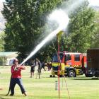Jason Watt, of Balclutha, hits his target at the Otago Southland Firefighters competition in...
