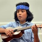 Jayden Jesudhass teaches the ukulele to an attentive class at Toitu Otago Settlers Museum yesterday.