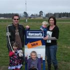 Jeff and Lavina Pockson with their children (from left) Eva, Kaelani and Charlie on the site of...