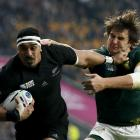 Jerome Kaino fends off Lodewyk de Jager during the All Blacks semifinal win over South Africa....