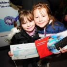 Calton Hill School pupils Jessica (7) and Renee (8) Carson show their mother Lorraine's...