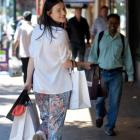 Jess Gleeson, of Dunedin fashion outlet Carlson, makes the most of George St yesterday, before a...
