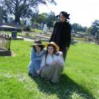 Jess Ransom, Alya McLean and Carol Krueger at Minnie Dean's unmarked grave at Winton Cemetery.