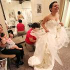 Jessica Vega, right, tries on the wedding gown in this 2010 file photo. (AP Photo/Times Herald...